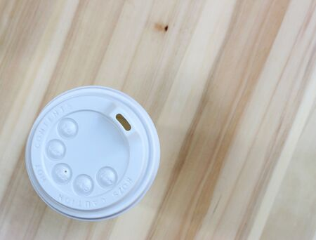 wooden lid: White coffee lid on wood background