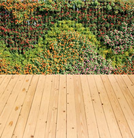 on wood floor: flower wall vertical garden and wood floor