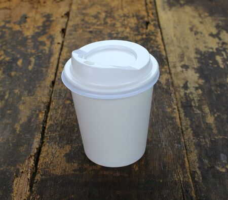 generic location: White paper cup of coffee on a wooden table Stock Photo