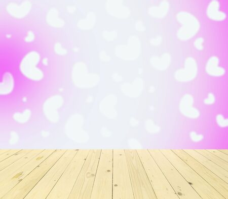 love shape: Wood table top on bokeh abstract background Stock Photo