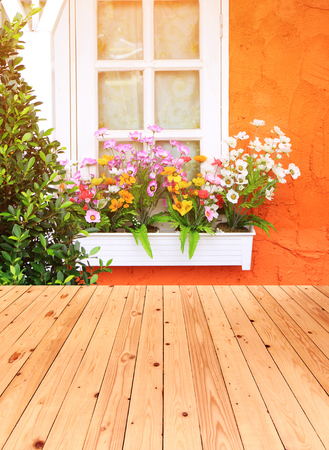 flower box: Flower box in window of orange building