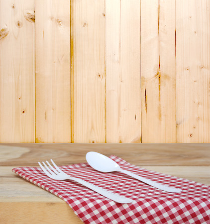 food absorption: tablecloth and spoon with fork for food serving background