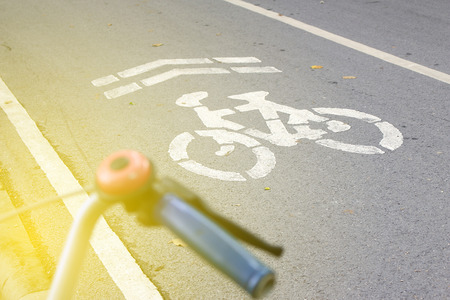 one lane roadsign: pathway for bike and cyclists with burst light Stock Photo