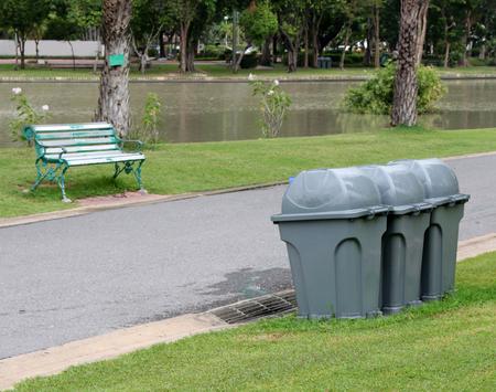 bins: Trash bins at outdoor park Stock Photo