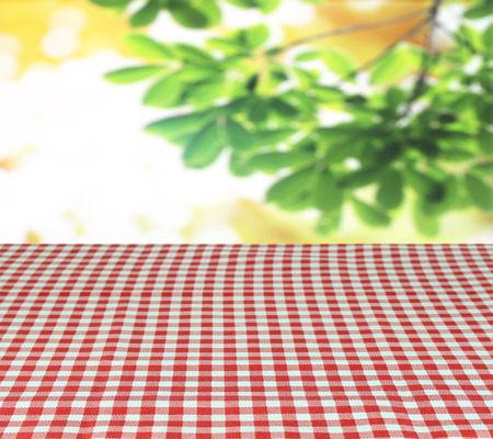 checkered tablecloth and blur leaves background Stock Photo