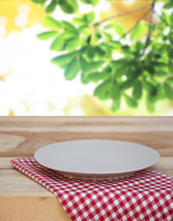 dish on checkered tablecloth and blur leaves background