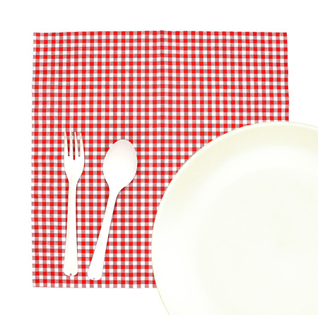 Top view plate with fork and spoon on tablecloth for food serving background