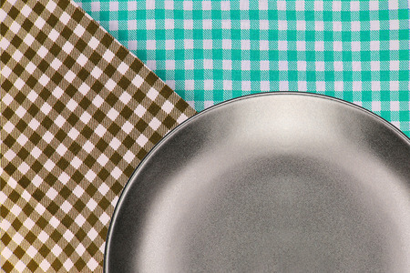 Top view plate on checkered tablecloth pattern background .Free space for products and for your text Stock Photo