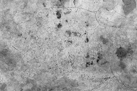 bstract: Aged cracked concrete stone plaster wall background and texture style