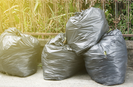 eliminate: black garbage bags on the ground to await disposal with sunlight