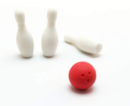 bowling ball and pin on white background