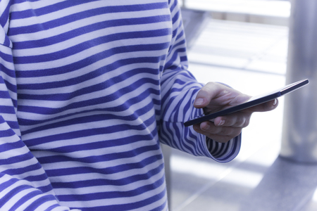 womans hands holding smart phone
