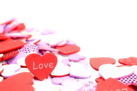 Valentine's Day background. White and red hearts with word love on white background. Valentines day concept. Flat lay, top view, copy space