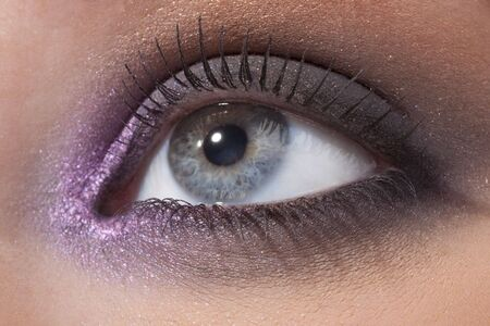 Details of beauty. Beautiful female eye in a fashionable make-up photo