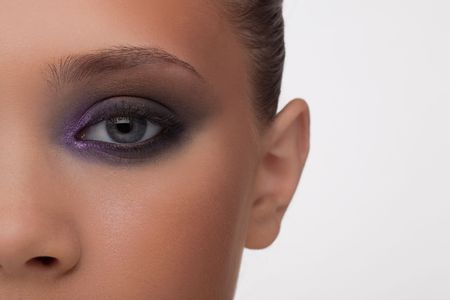 professionally: Fragment of a fine womans face in a fashionable make-up professionally done.