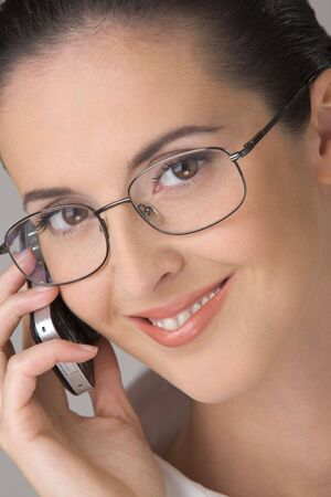 shortsightedness: The young beautiful woman in points, smiling, speaks by phone. Stock Photo