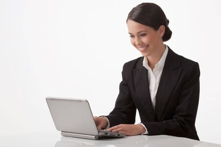 joyfully: The young woman joyfully with pleasure works on a computer Stock Photo