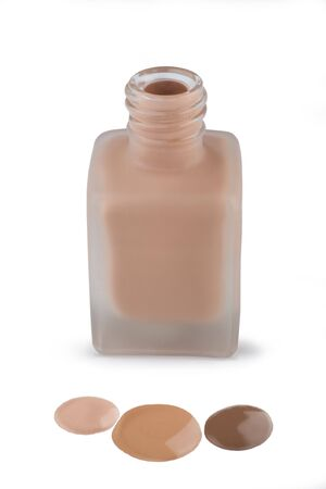 matte: Face make-up in glass matte bottle and three drops of Foundation cream, close-up on white background.