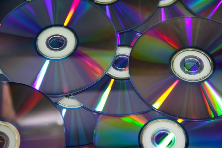 Background of compact discs with colour light photo