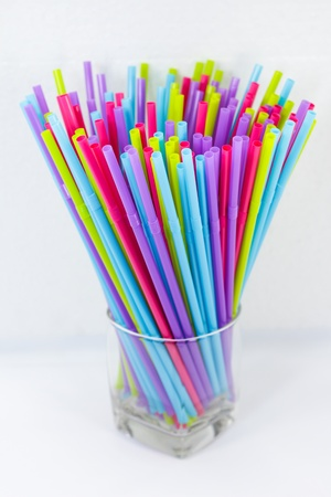 Cocktail straws in glass on a white background Stock Photo - 14241584