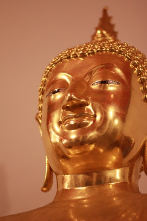 Golden buddha statue face in wat pho photo