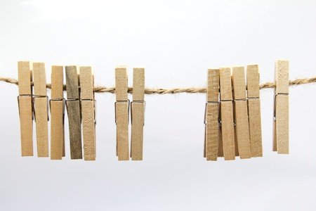 Clothes peg hang on clothesline Stock Photo - 14241608