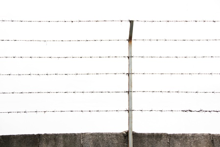 Barbed wires and steel pole isolated photo