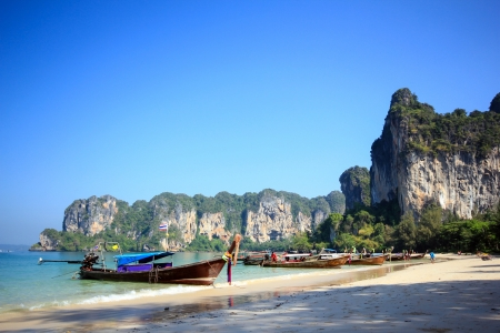 Longtail boat and blue sky at Railay Beach Thailand photo
