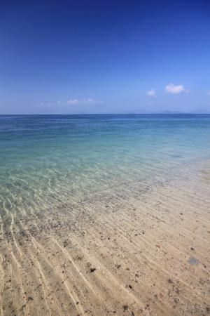 Sand Beach and sea and blue sky at koh puk bia andaman thailand photo