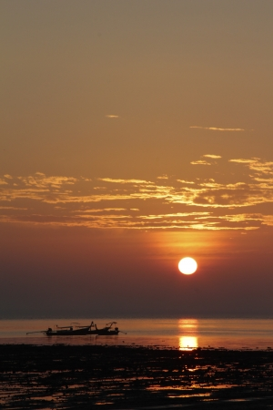 Silhouette Longtail boat in the Morning at railay thailand photo