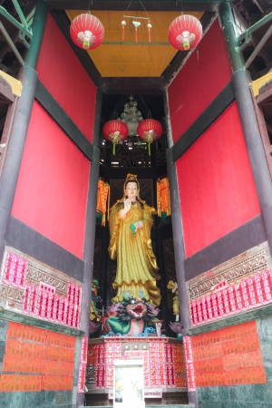 Guan Yin in red pagoda photo