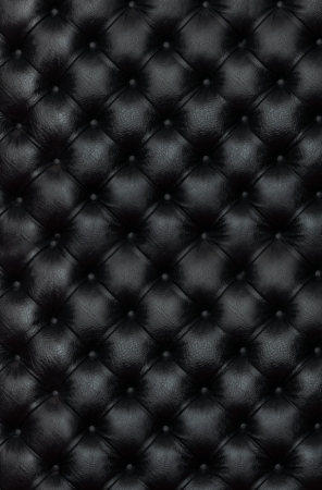 leather armchair: picture of black genuine leather wallpaper Stock Photo