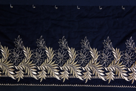 embroidery on fabric: gold leaf lacework on black background