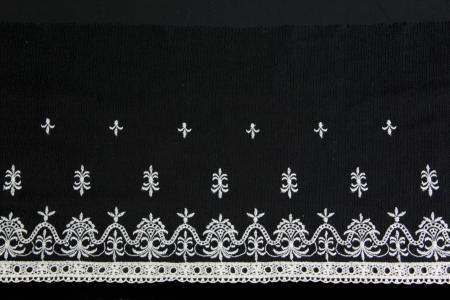 white antique lacework on black background