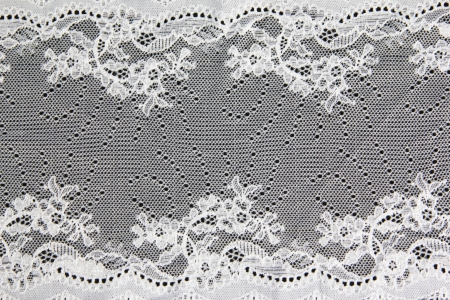 white folwer lacework on black background photo
