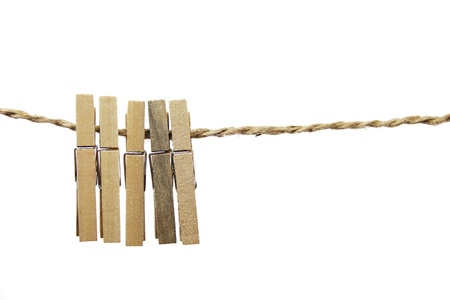 Wooden clothes clips isolated on rope Stock Photo - 16148106