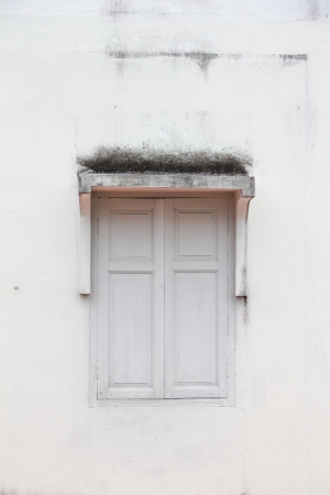 white window on grunge wall