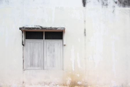 white window on grunge wall photo