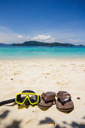 Snorkeling set and thongs shoe on beach at Coral IsIand ,Phuket Stock Photo
