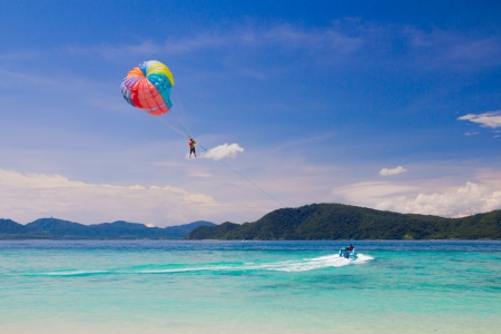 Parasailor Activity on Beautiful  blue sea in thailand photo