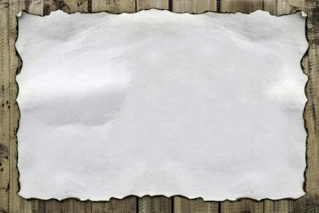 burnt paper on  grunge  wood