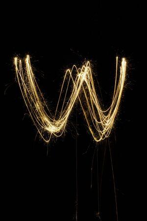 christcross: sparkler firework light alphabet