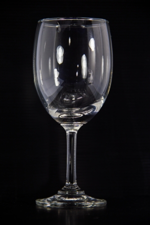 Empty wine glass  isolated on a Black background Stock Photo - 16697026
