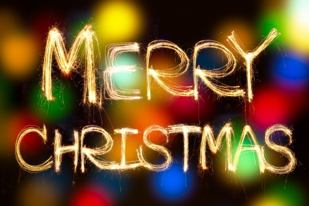 merry christmas written with Sparkling figures  on bokeh background Stock Photo