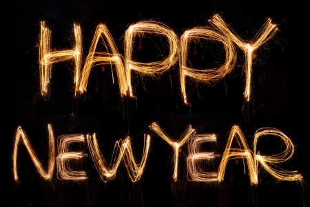 happy new year written with Sparkling figures Stock Photo - 16697336