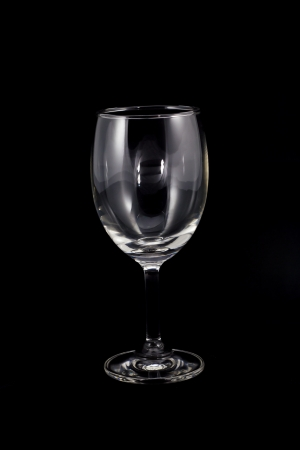 Empty wine glass  isolated on a Black background Stock Photo - 16696942