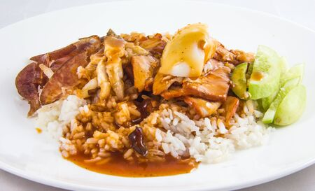 thai food,serving of rice with roasted pork on top