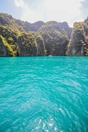 Cliff and the clear sea on phi phi bay ,krabi,thailand photo