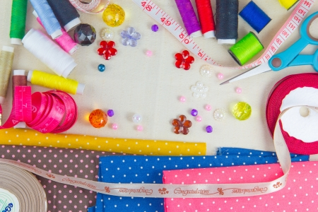 Tools for sewing and handmade  thread, scissors, pins on brown paper Stock Photo - 17469101
