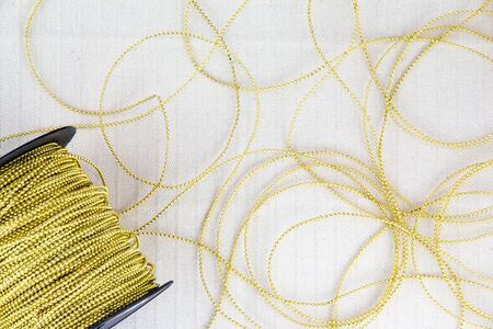 gold Thread on white canvas Stock Photo - 17469170